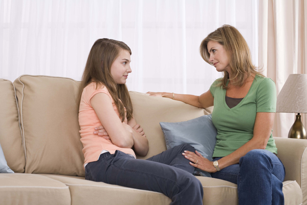 mother-and-teenage-daughter-talking-abou